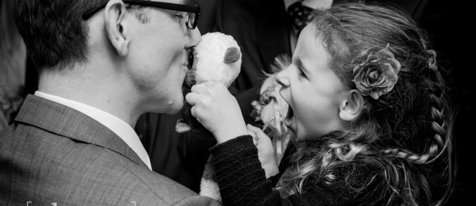 Groom kissing teddy bear