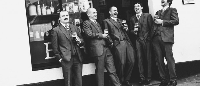 Groomsmen having a Guinness