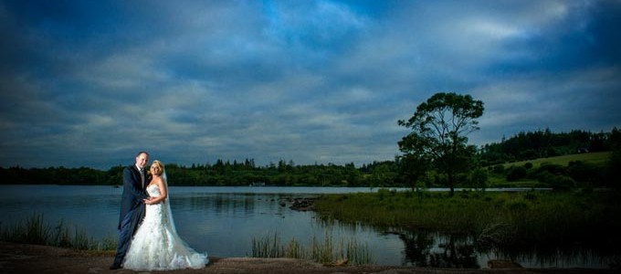 Bride and Groom on jetty at Harvey's Point Hotel, Lough Eske, Donegal Town