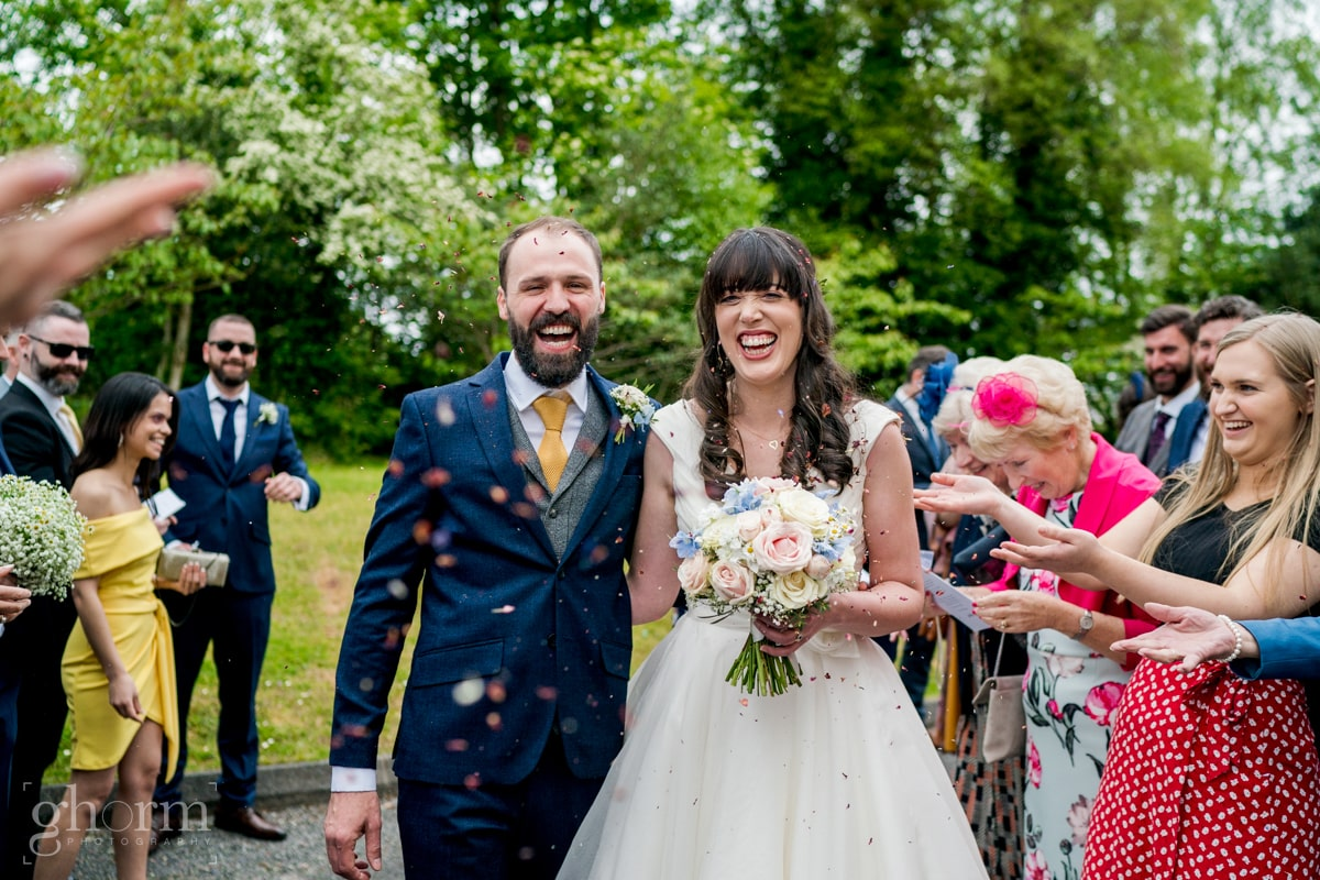 Harveys Point hotel Wedding, Paul McGinty Ghorm Studio Photography, spring wedding, confetti throwing