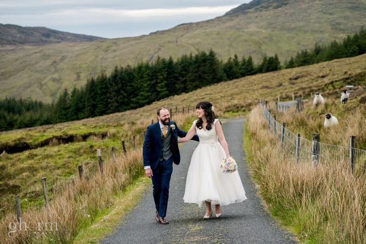 Harveys Point hotel Wedding, Paul McGinty Ghorm Studio Photography, spring wedding, the bride and groom in the blue stack mountains with some sheep