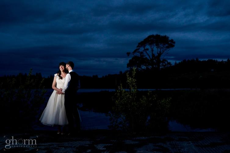 Harveys Point hotel Wedding, Paul McGinty Ghorm Studio Photography, spring wedding, nighttime photo on the pier at harveys point