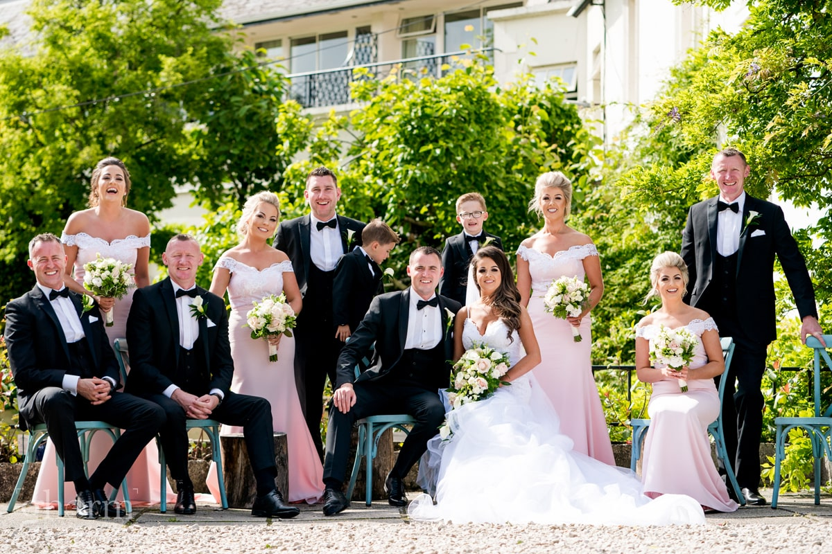 Silver Tssie hotel Wedding, Wedding Photographer Donegal, Sligo & Leitrim, Bride and groom in the Cathedral Letterkenny with the veil blowing in the wind. Donegal Wedding Photographer, Paul McGinty, Ghorm Studio Photography. The bridal party sitting outside Rathmullan house, co Donegal.