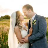 bride and groom staying in afield behind the silver tassie hotel, letterkenny, Co Donegal as the sun was setting, linked arm in arm. Photo by Paul McGinty from Ghorm Studio Photography.