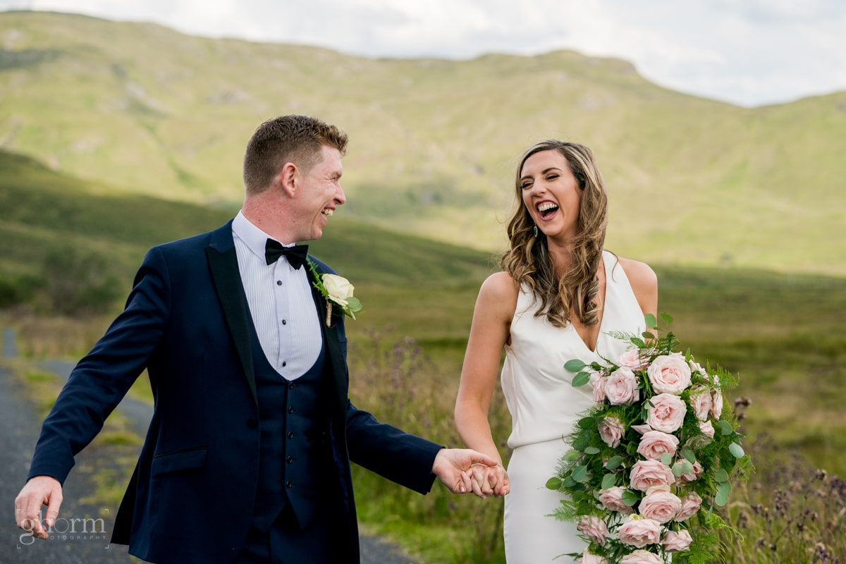 the bride and groom walking through the blue stack mountains, drimarone, Mill park hotel wedding, Donegal Town, Photos by Paul McGinty from Ghorm Studio Photography