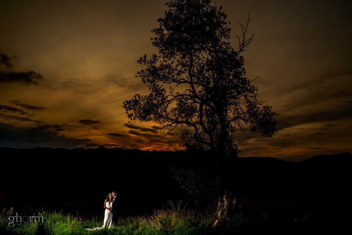 The bride and groom under a big tree at sunset, Mill park hotel wedding, Donegal Town, Photos by Paul McGinty from Ghorm Studio Photography