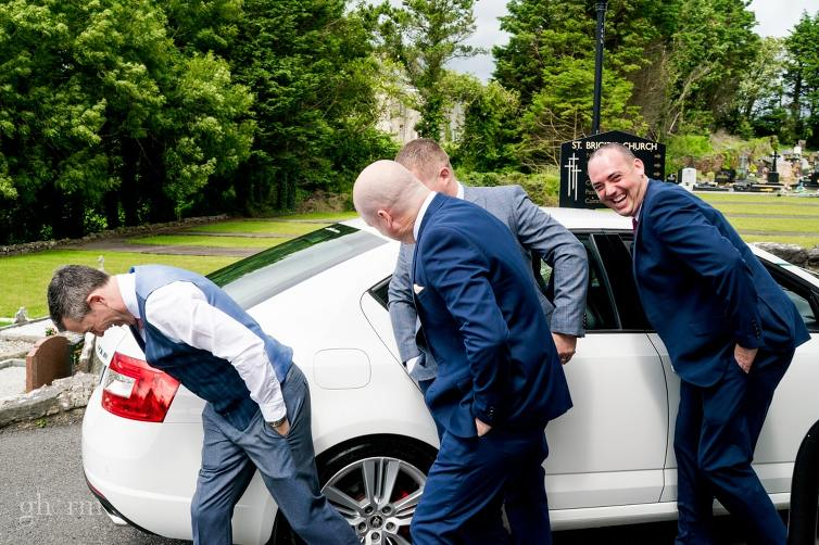 Boys hiding from the camera. Bride and groom on their wedding day in the Villa Rose hotel Ballybofey, Co Donegal, Ireland. Photo by Paul McGinty from Ghorm Studio Photography