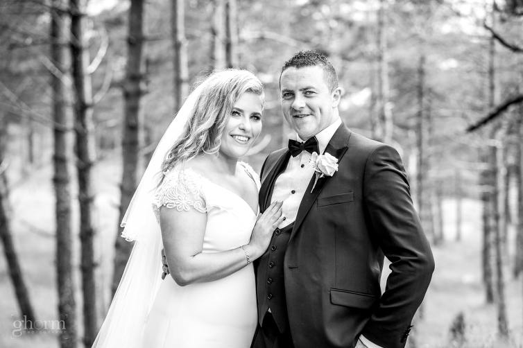 bride and groom in the forest in murvagh, Bride and groom on their wedding day in the Villa Rose hotel Ballybofey, Co Donegal, Ireland. Photo by Paul McGinty from Ghorm Studio Photography