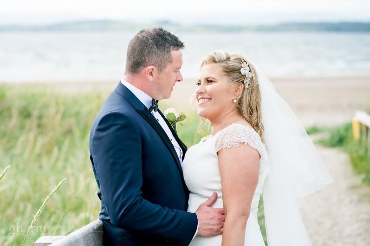 bride and groom on the beach in donegal, Bride and groom on their wedding day in the Villa Rose hotel Ballybofey, Co Donegal, Ireland. Photo by Paul McGinty from Ghorm Studio Photography