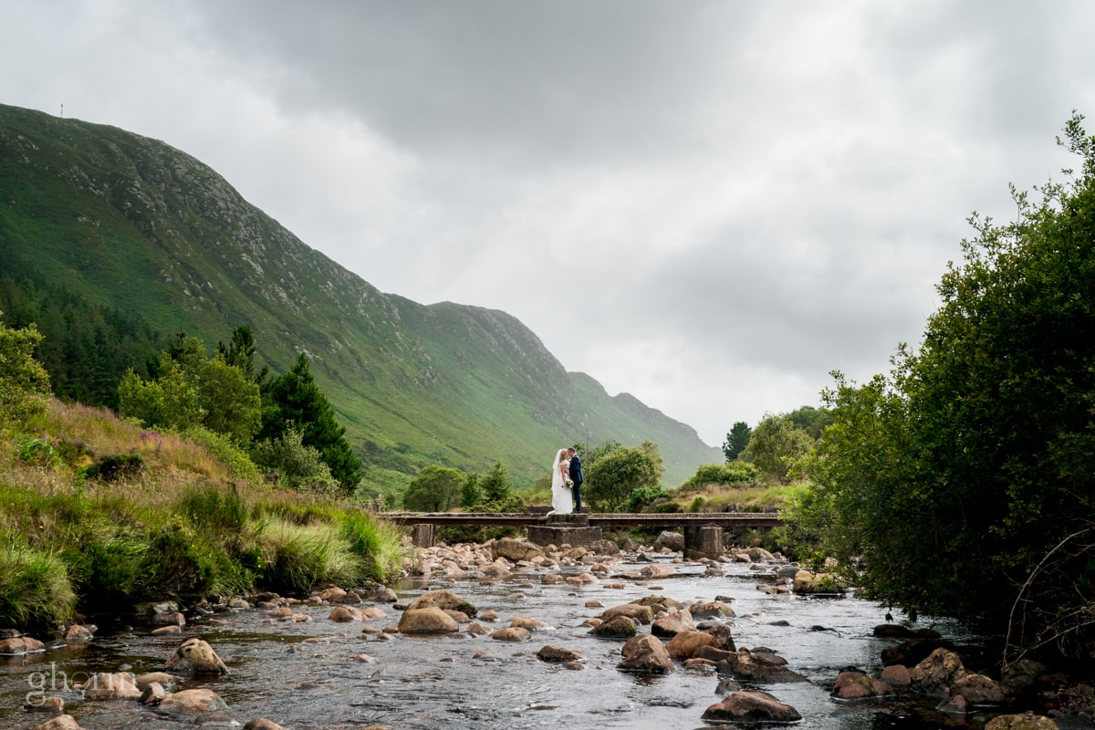 bride and groom on a bridge in the middle of Barnesmore Gap, Bride and groom on their wedding day in the Villa Rose hotel Ballybofey, Co Donegal, Ireland. Photo by Paul McGinty from Ghorm Studio Photography