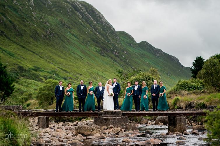 The bridal party on a bridge over a river in Barnesmore gap,Bride and groom on their wedding day in the Villa Rose hotel Ballybofey, Co Donegal, Ireland. Photo by Paul McGinty from Ghorm Studio Photography