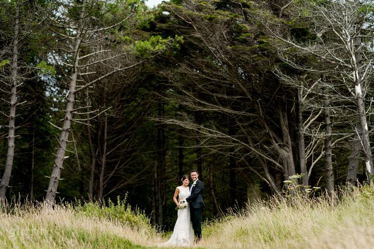 bride and groom groom in front of a forest at an irish beach, Lough Eske Castle wedding, Photos by Paul McGinty from Ghorm Studio Photography