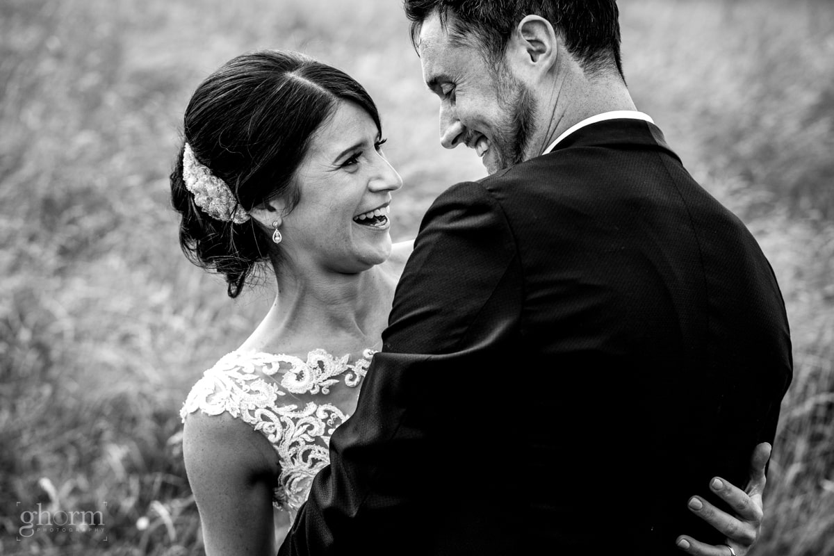 bride and groom having a laugh on a beach, Lough Eske Castle wedding, Photos by Paul McGinty from Ghorm Studio Photography