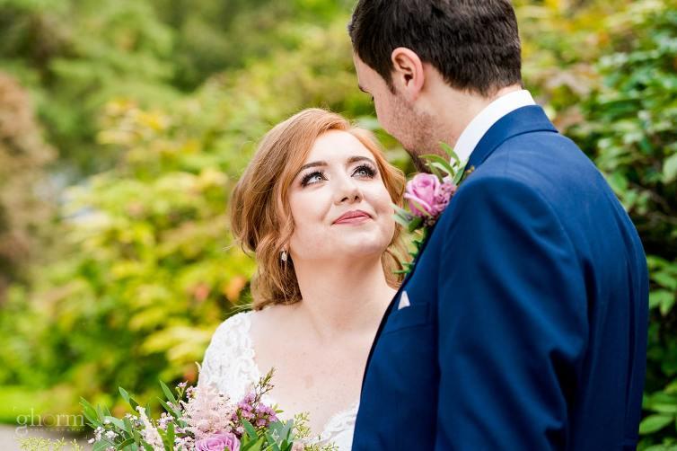 bride smiling at the groom in the glebe gallery, tartan,