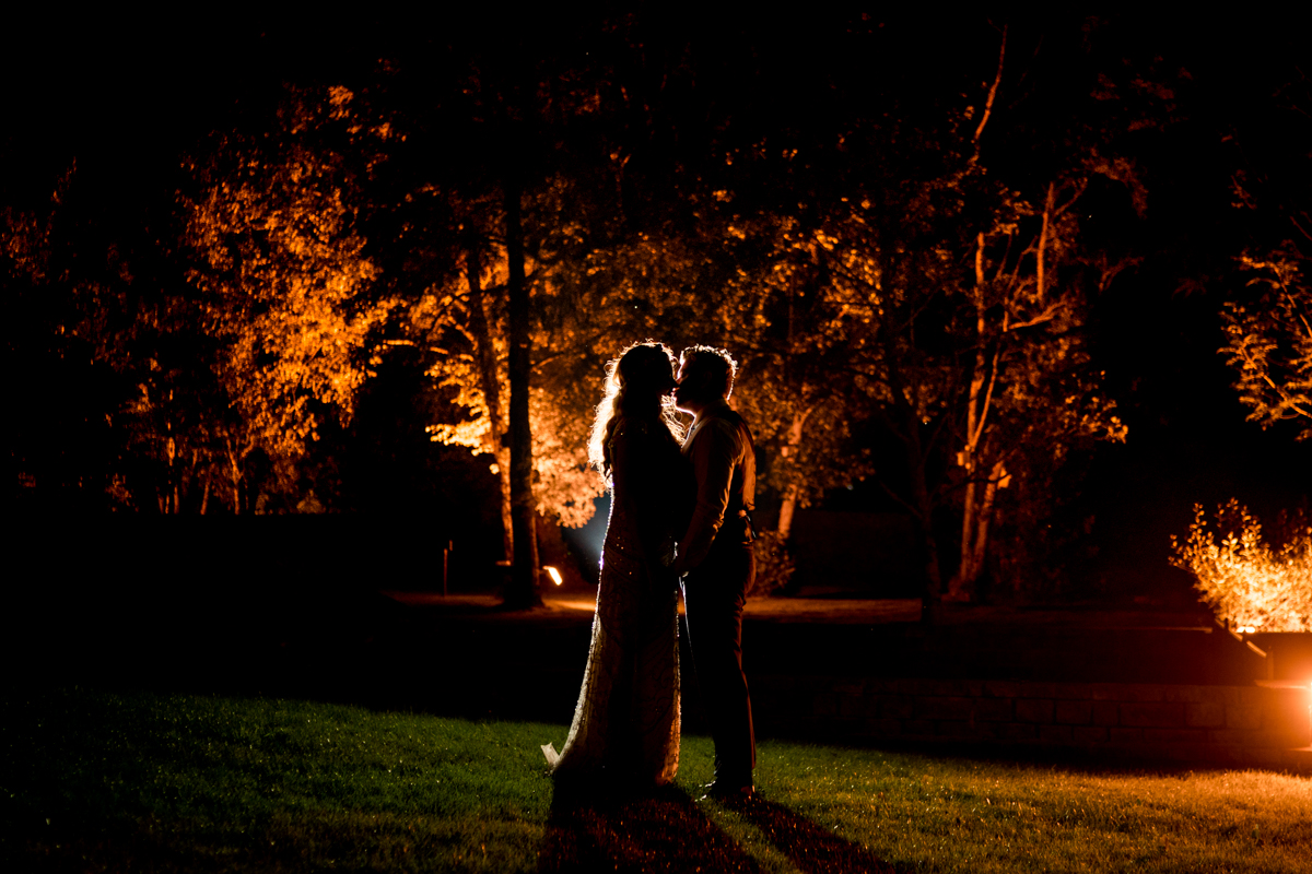 Bride and groom outside Harveys Point hotel on their wedding day as the sun was setting, Photo by Paul McGinty from Ghorm Studio Photography