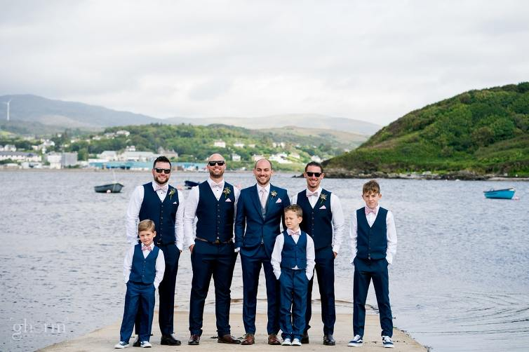the groom and his groomsmen with Killybegs harbour behind, Claire and Lachlan