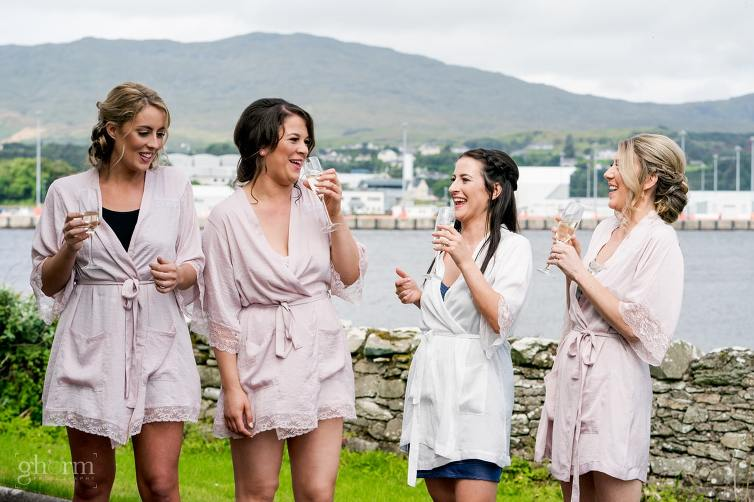 Bride and her bridesmaids having a laugh and a drink of champagne , Claire and Lachlan