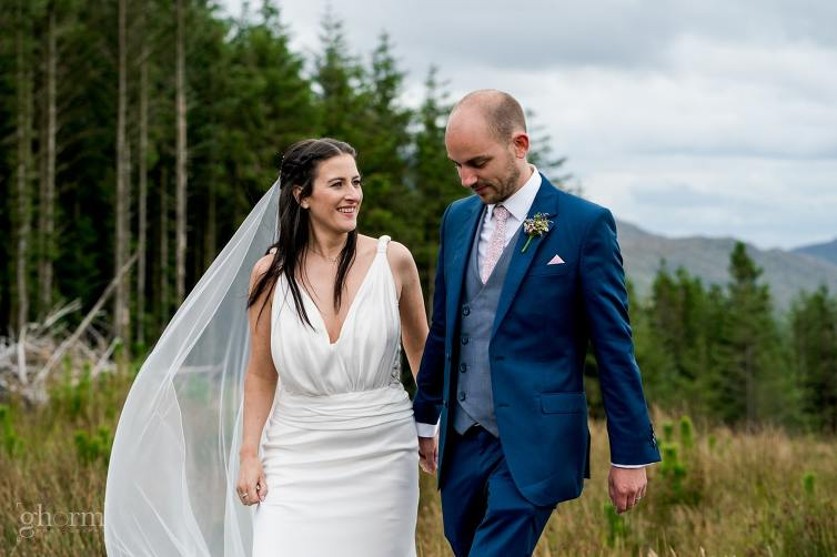 Bride nd groom having as laugh as they walk through the hills of Donegal