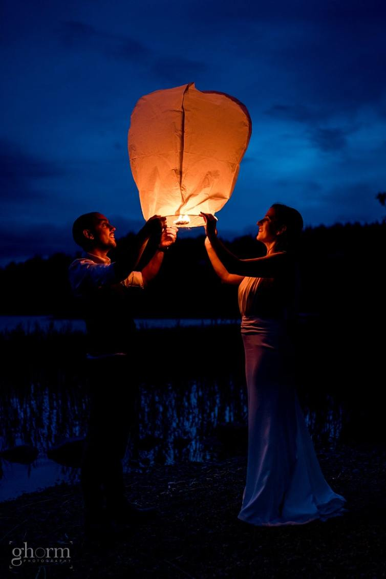 bride and groom lighting a chines lantern at night, Claire and Lachlan