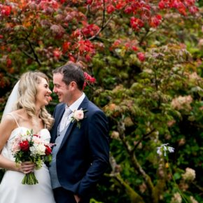 Mill Park hotel wedding, photos by Paul McGinty fromBride and groom in the salthill gardens, Mountcharles in front of a beautiful red tree in autumn,Ghorm Studio Photography