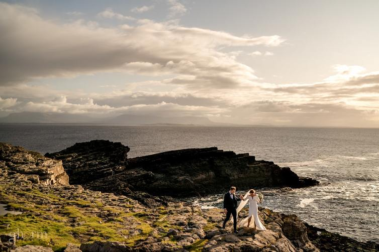 Bride and groom on the sea cliffs at St John Point Lighthouse. Phot by Paul McGinty from Ghorm Studio Photography, Lough Eske, Donegal Town. Dearbhla and Michael got married in St Marys Church Killybegs with the reception afterwards in Lough Eske Castle, Co Donegal.