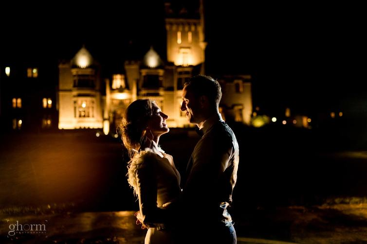 Bride and groom outside Lough Eske castle at night. Photo by Paul McGinty from Ghorm Studio Photography, Lough Eske, Donegal Town. Dearbhla and Michael got married in St Marys Church Killybegs with the reception afterwards in Lough Eske Castle, Co Donegal.