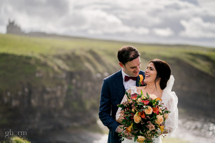 Markree Castle wedding photographer, Photo by Paul McGinty , Ghorm Studio Photography Bride and groom on the cliffs at Mullaghmore with Cassie Bann as the rain came down.