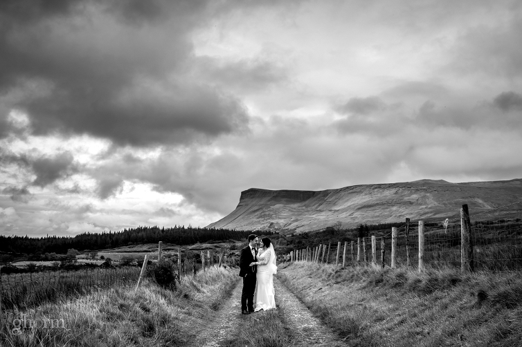 bride and groom in the sligo mountains in black and white, Markree Castle wedding photographer, Photo by Paul McGinty , Ghorm Studio Photography