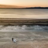 bride and groom walking hand in hand down a donegal beach photos by drone. Donegal, sligo and Leitrim wedding photographer, Paul McGinty , ghorm studio Photography, Louise and Daniel had their wedding iceremony in Ballyshannon and their wedding reception in the Mill Park hotel, Donegal Town.
