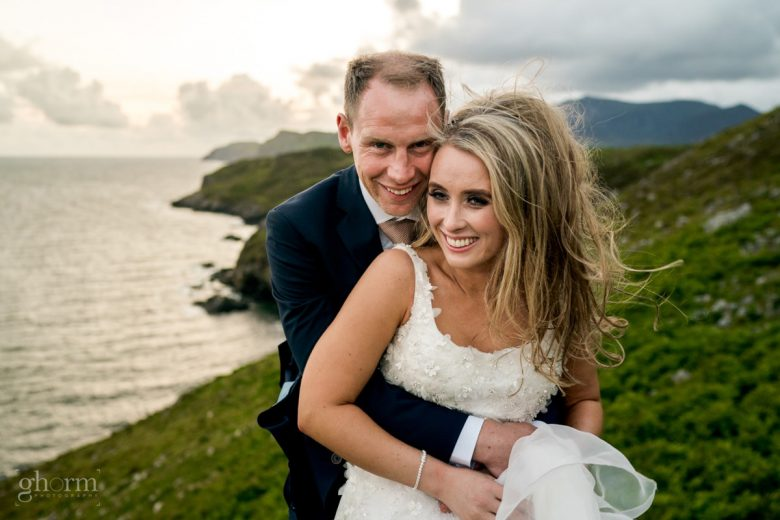 bride and groom on the cliffs at muckross head with sliabh liar in the background