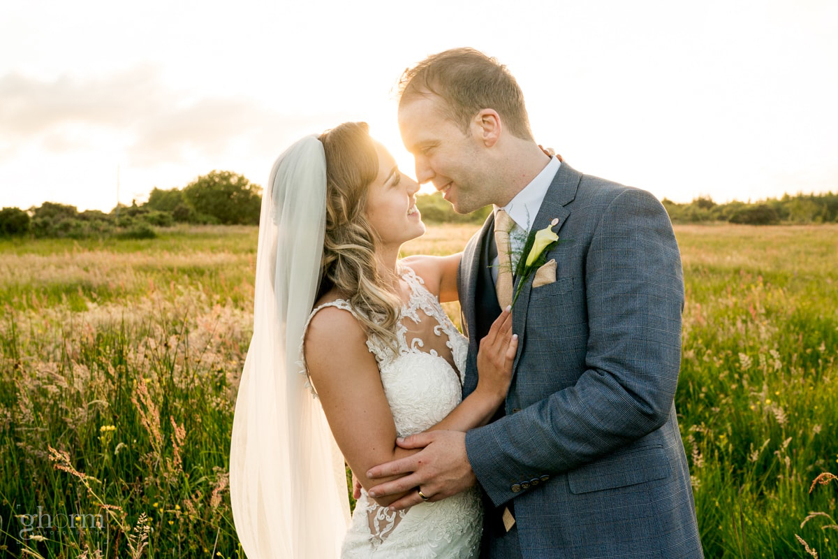 Bride and groom as the sunsets behind the Silver tassie hotel, Letterkenny, Co Donegal Ireland