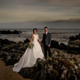 Bride and groom on the rocks at white stroove beach, Movie, co Donegal, Ireland. A preview from Dara and Alan