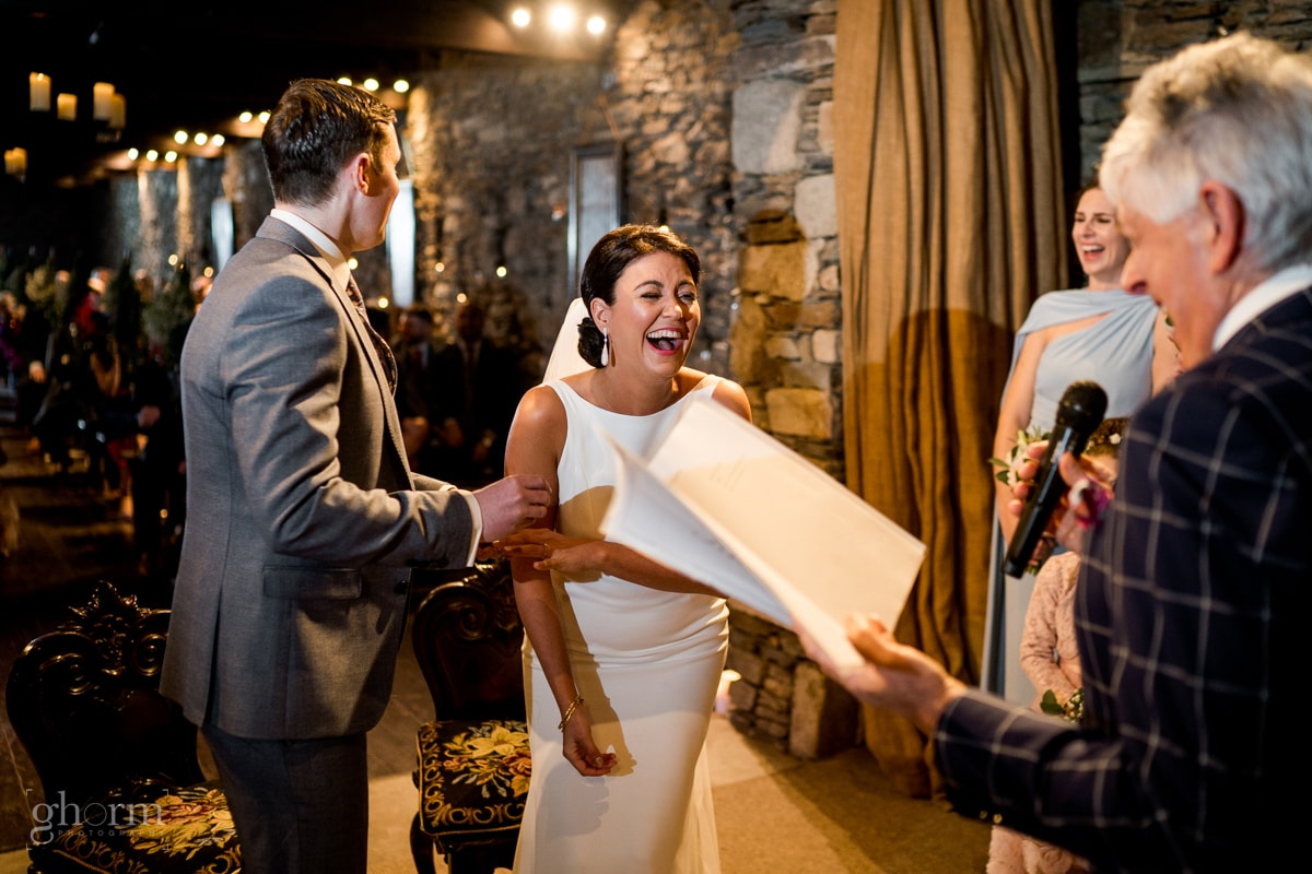 Bride and groom having a laugh during the ceremony in the church at Ballybeg House Co Wicklowklow, Ireland, Photo by Paul McGinty, Ghorm studio photography