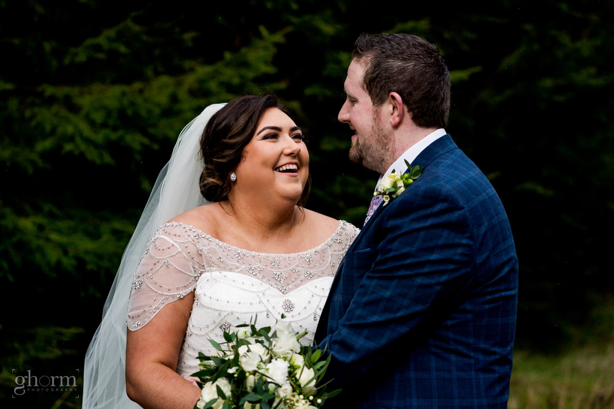 Bride and groom having a laugh in a forest in Cavan, Ireland, Errigal Country House wedding, natural wedding photographer Donegal, Cavan, Sligo and leitrim, Paul McGinty from Ghorm Studio Photography based at Lough Eske, Donegal Town.