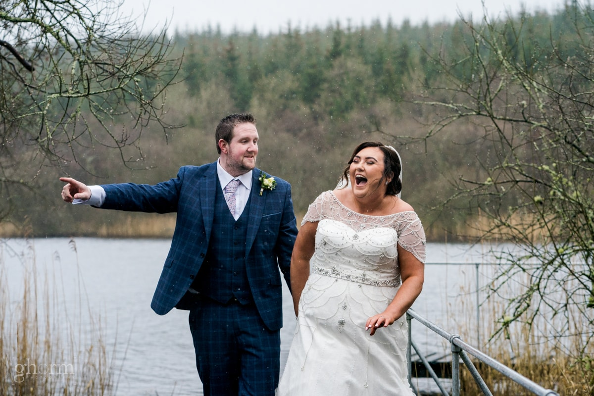 Bride and groom laughing as they walk along a jetty. Errigal Country House wedding, natural wedding photographer Donegal, Cavan, Sligo and leitrim, Paul McGinty from Ghorm Studio Photography based at Lough Eske, Donegal Town.