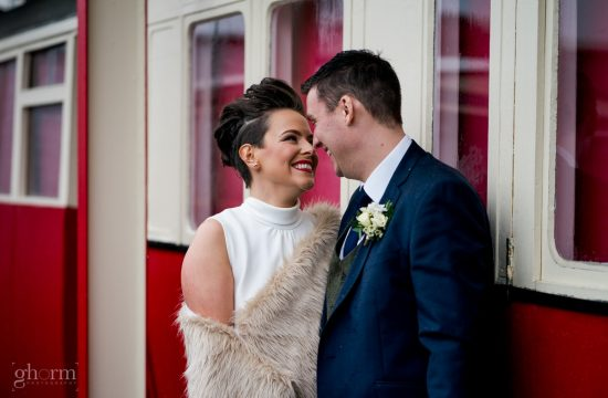 Bride and groom in at the train station Donegal town, wedding in Harvey's Point , Lough Eske, Ireland. Photo by Paul McGinty, Ghorm Studio Photography.