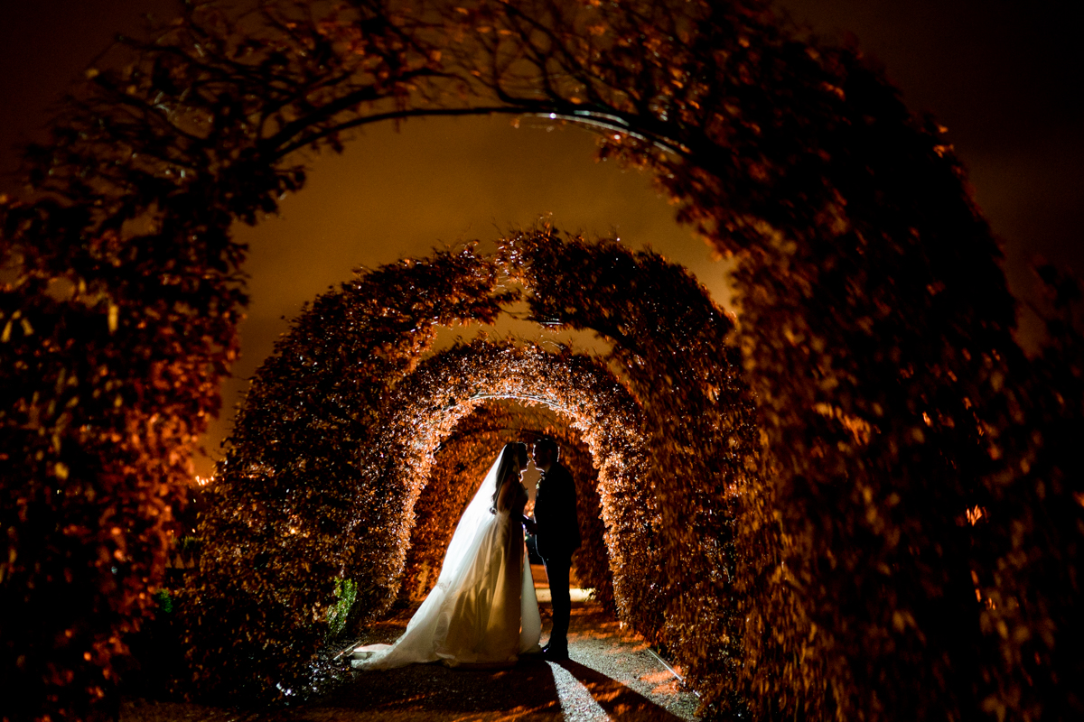 Wedding in Rockhill House, Letterkenny, Co Donegal, Bride and groom under an umbrella at night in the garden, photo by Paul McGinty, Ghorm Studio Photography