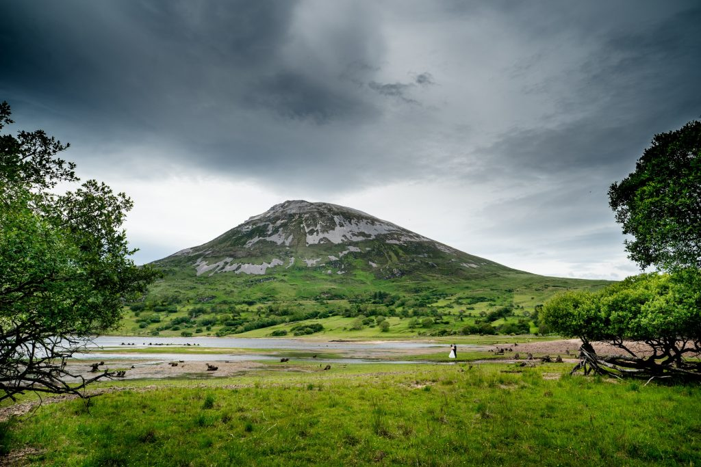 bride and groom, under mount Errigal with Dunlewy lake in the background. Photography by Paul McGinty, Ghorm Studio Photography