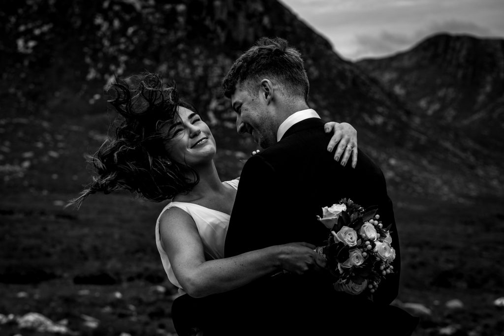Bride and groom having a kiss in the Poisoned Glen. Photography by Paul McGinty, Ghorm Studio Photography