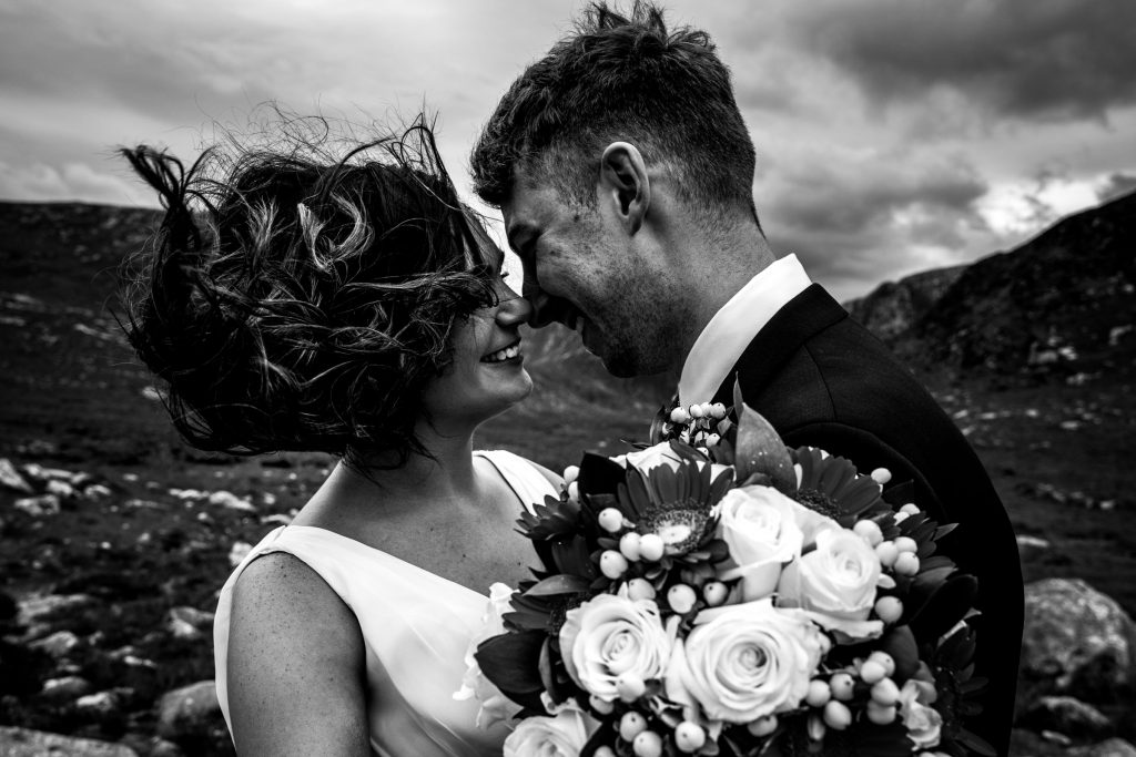 Black and white photos of a bride and groom a the wind blows through the brides hair. Photography by Paul McGinty, Ghorm Studio Photography