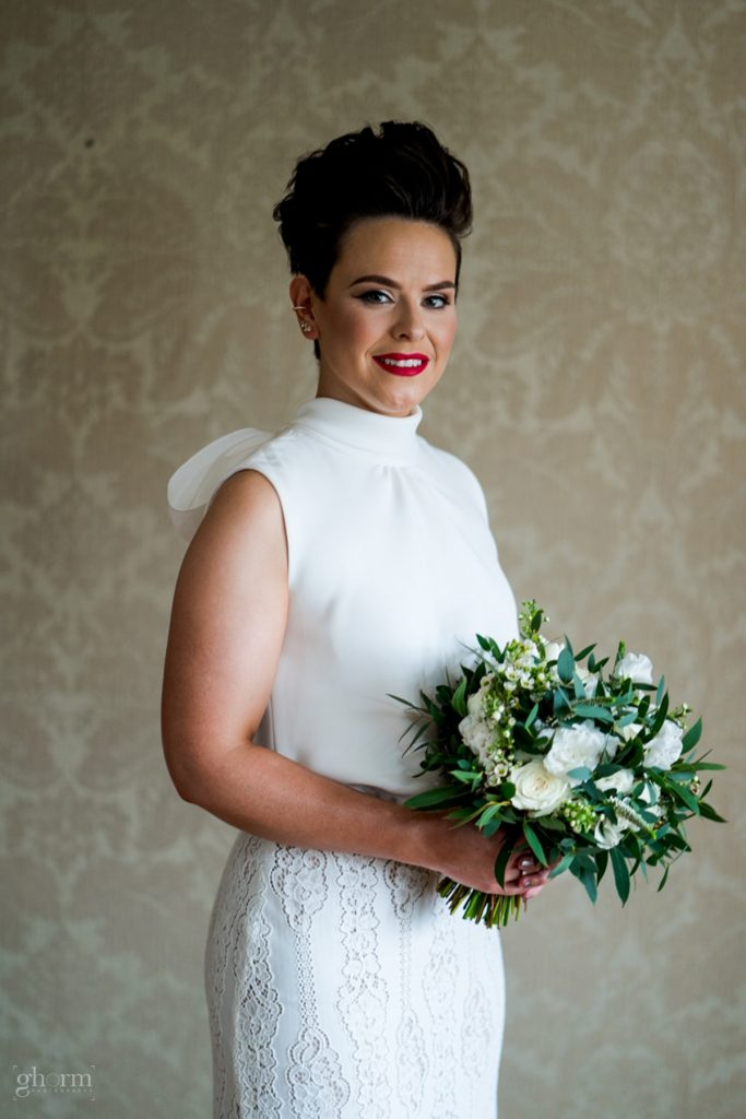 the bride and her bouquet, bride and groom in donegal best wedding venue, harvey's point hotel on the shore of Lough Eske, Ghorm Studio Photography, donegal, sligo and leitrim wedding photographer