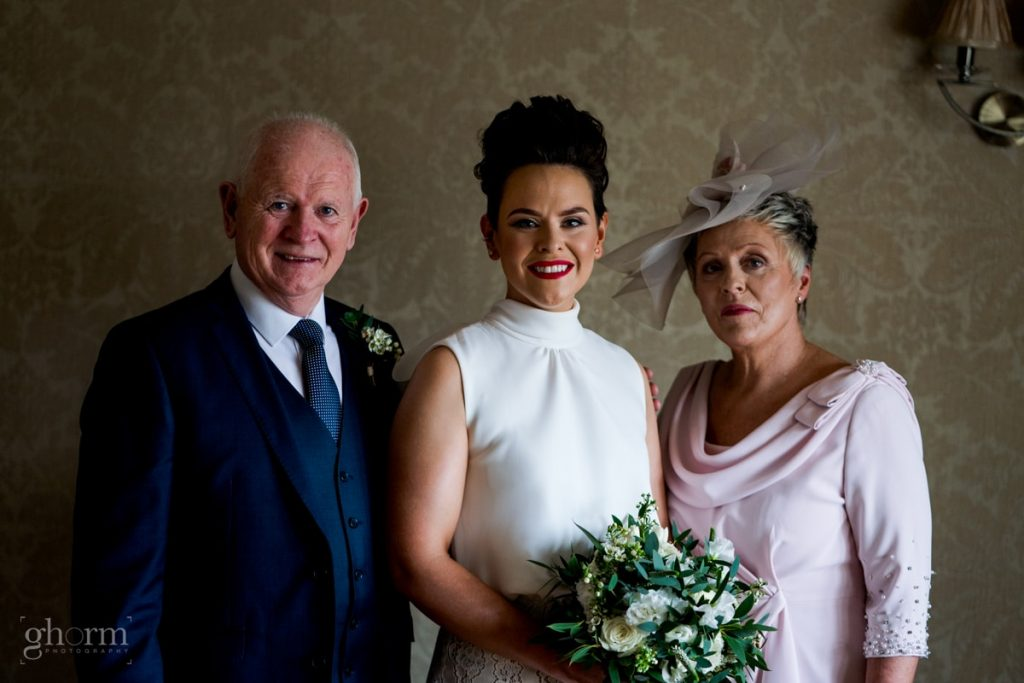 the bride and her parents, bride and groom in donegal best wedding venue, harvey's point hotel on the shore of Lough Eske, Ghorm Studio Photography, donegal, sligo and leitrim wedding photographer