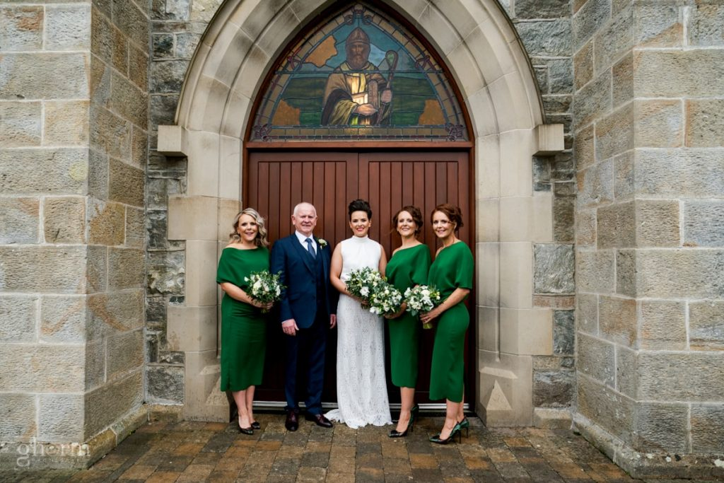 the bride , her father and bridesmaids outside the church, bride and groom in donegal best wedding venue, harvey's point hotel on the shore of Lough Eske, Ghorm Studio Photography, donegal, sligo and leitrim wedding photographer