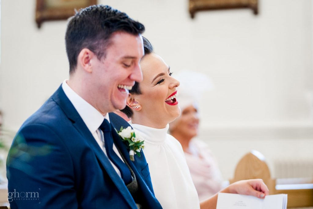 the bride and groom in the ceremony having a laugh, bride and groom in donegal best wedding venue, harvey's point hotel on the shore of Lough Eske, Ghorm Studio Photography, donegal, sligo and leitrim wedding photographer