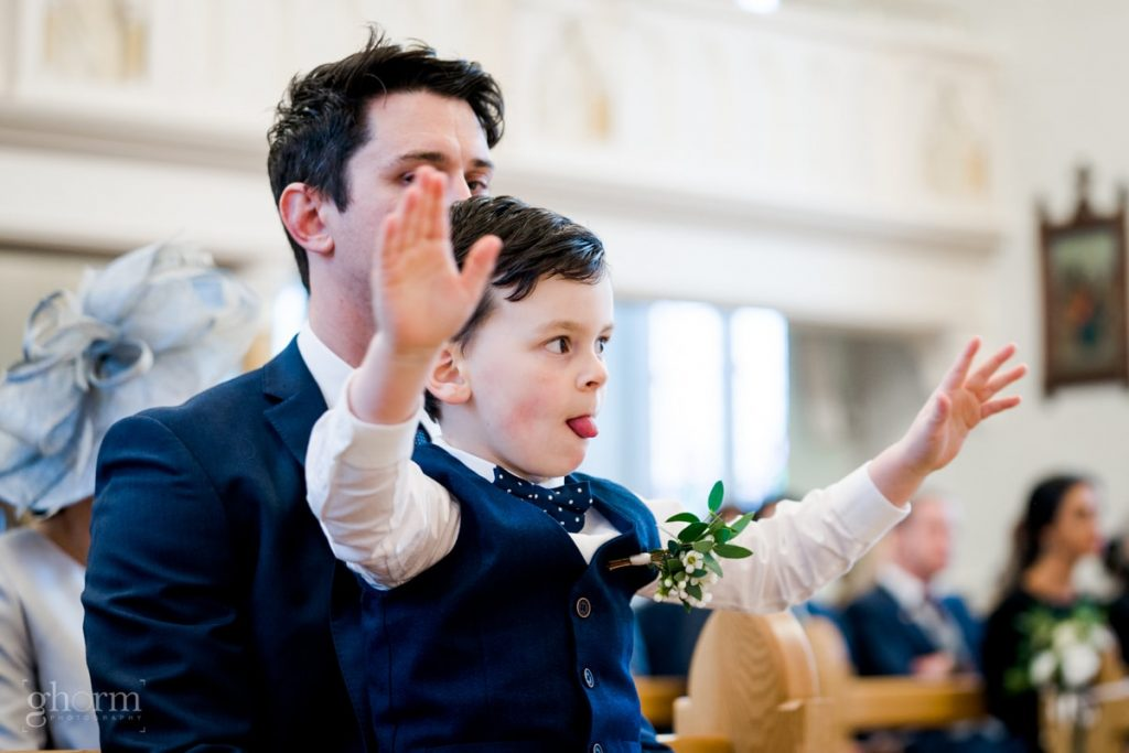 the pageboy in church, bride and groom in donegal best wedding venue, harvey's point hotel on the shore of Lough Eske, Ghorm Studio Photography, donegal, sligo and leitrim wedding photographer
