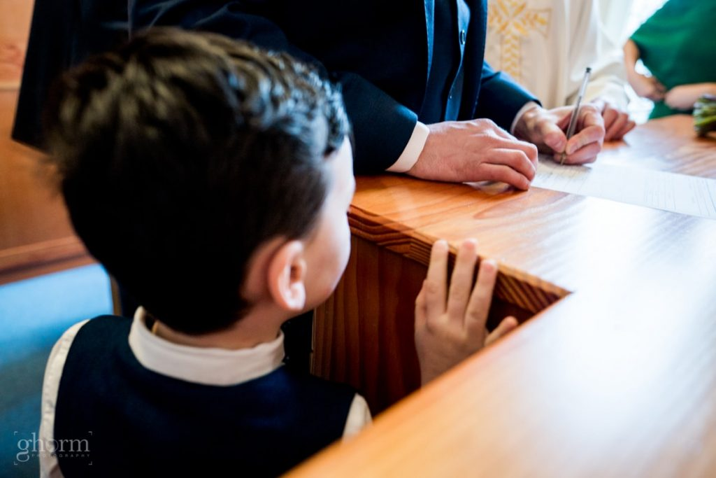 signing the register, bride and groom in donegal best wedding venue, harvey's point hotel on the shore of Lough Eske, Ghorm Studio Photography, donegal, sligo and leitrim wedding photographer