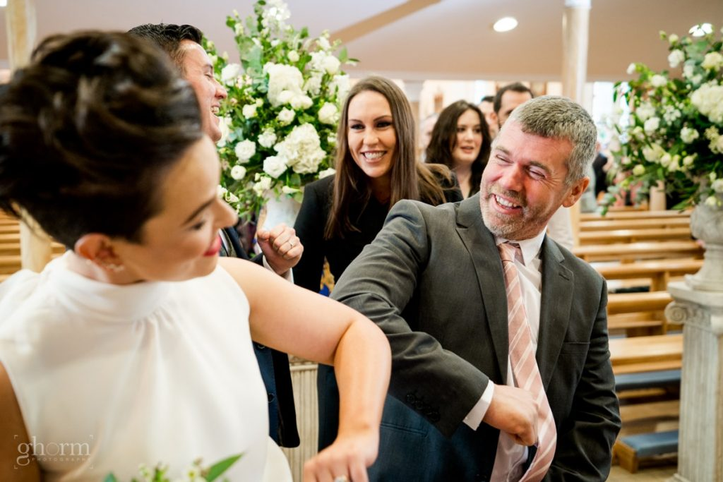 guest greeting the bride and groom, bride and groom in donegal best wedding venue, harvey's point hotel on the shore of Lough Eske, Ghorm Studio Photography, donegal, sligo and leitrim wedding photographer