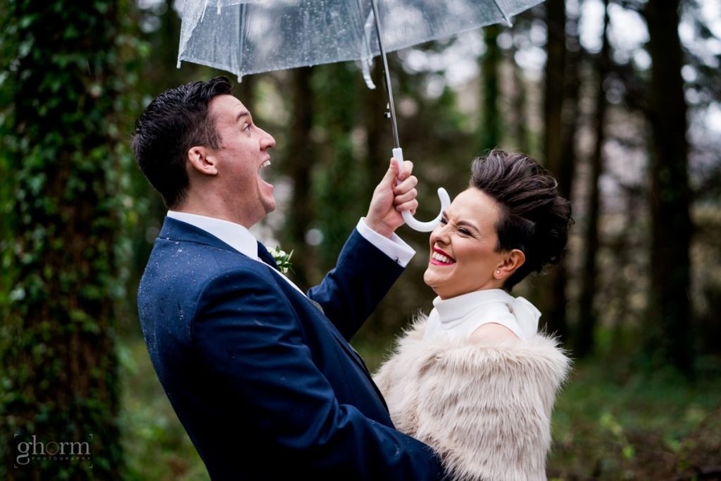 the bride and groom laughing in a forest, bride and groom in donegal best wedding venue, harvey's point hotel on the shore of Lough Eske, Ghorm Studio Photography, donegal, sligo and leitrim wedding photographer