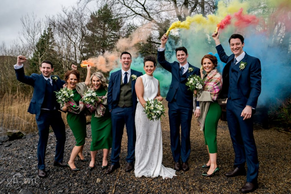 bridal party with smoke bombs, bride and groom in donegal best wedding venue, harvey's point hotel on the shore of Lough Eske, Ghorm Studio Photography, donegal, sligo and leitrim wedding photographer