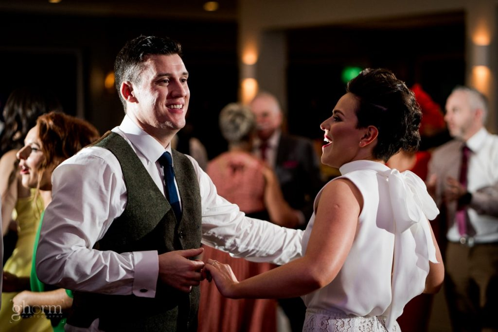 the bride and groom dancing, bride and groom in donegal best wedding venue, harvey's point hotel on the shore of Lough Eske, Ghorm Studio Photography, donegal, sligo and leitrim wedding photographer